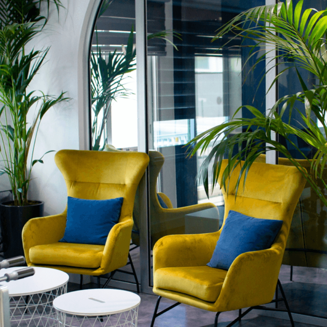 Two yellow armchairs with blue cushions
